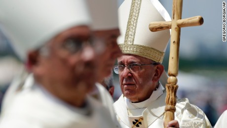Pope Francis walks with his pastoral staff to celebrate a Mass in Guayaquil, Ecuador, Monday, July 6, 2015. Latin America's first pope arrived in this port city on Monday for the first big event of a three-nation tour where he's set compassion for the weak and respect for the environment as central themes. (AP Photo/Gregorio Borgia)