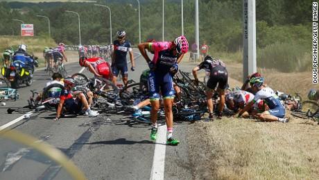 Filippo Pozzato of Italy and Lampre-Merida adjusts his clothing following a crash near Brabant Wallon.