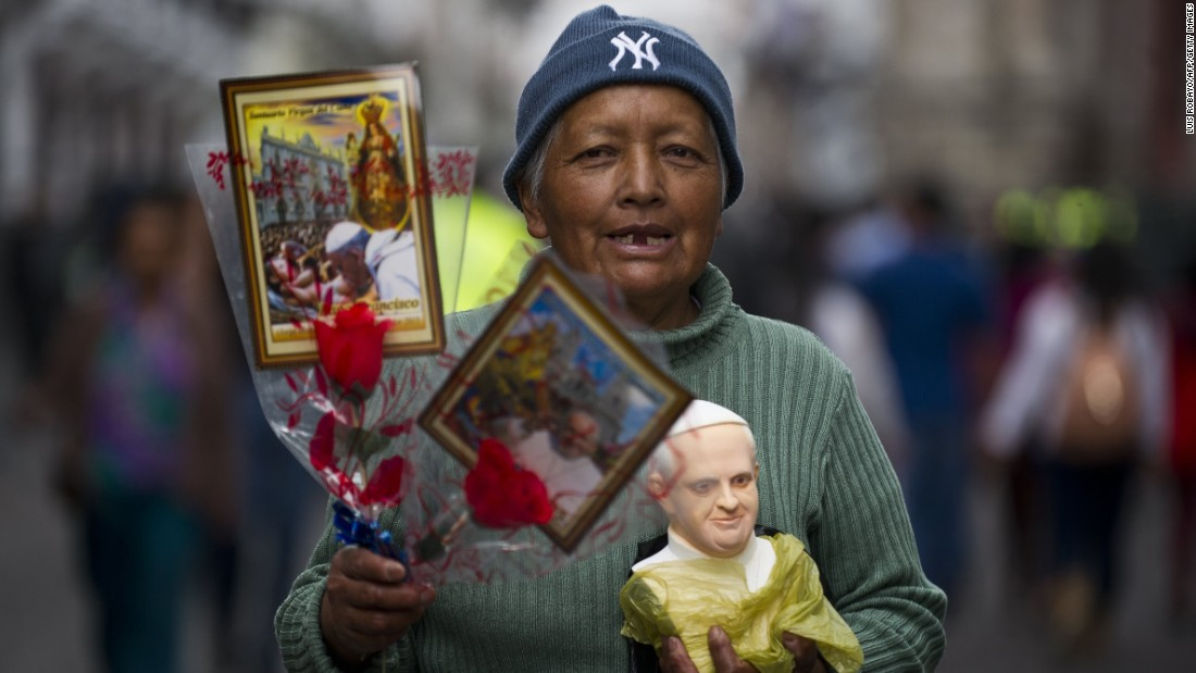 A woman in Quito, Ecuador, sells images and a bust of Pope Francis on Monday, July 6.