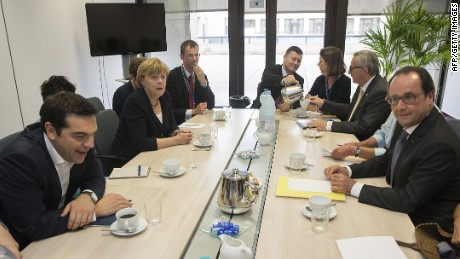 Greek Prime minister Alexis Tsipras (L), German Chancellor Angela Merkel (2ndL), European Commission President Jean-Claude Juncker (2ndR) and French President Francois Hollande (R) meet at the European Union (EU) headquarters in Brussels on July 7, 2015 ahead of an emergency EU summit after Greeks defiantly voted 'No' to further austerity. Greek Prime Minister is to face his 18 eurozone counterparts as the country's economy gasps for air, with banks closed until at least July 9 amid fears the Greek financial system is imploding. AFP PHOTO / POOL / PHILIPPE WOJAZERPHILIPPE WOJAZER/AFP/Getty Images