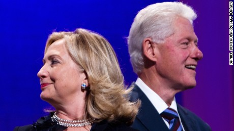 Former U.S. President Bill Clinton (R) stands on stage with his wife Hillary Rodham Clinton, Secretary of State during the closing Plenary session of the seventh Annual Meeting of the Clinton Global Initiative (CGI) at the Sheraton New York Hotel on September 22, 2011 in New York City.