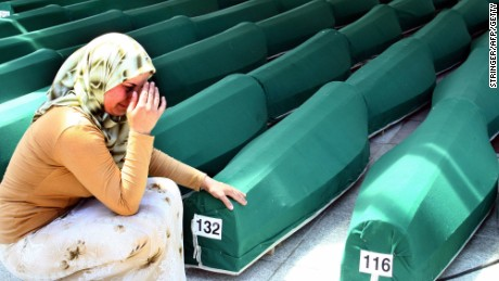 A Bosnian woman weeps next to the coffins of Muslim men and boys before their burial in Potocari, near Srebrenica, East Bosnia and Herzegovina, 11 July 2004.