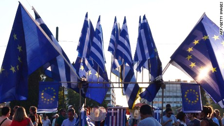 Pro-European Union protesters wave EU flags in front of the Greek parliament in Athens during a demonstration by a ' we stay in Europe' movement on July 9, 2015. Greece was to submit a detailed bailout request to its eurozone partners on July 9 in a last-ditch effort to save its collapsing economy and its place in the euro, in an unprecedented test of EU cohesion. With the crisis reaching a climax that could have unpredictable consequences, the EU president urged creditors to compromise on granting debt relief to Greece. AFP PHOTO/ LOUISA GOULIAMAKI - FRANCE OUT -LOUISA GOULIAMAKI/AFP/Getty Images