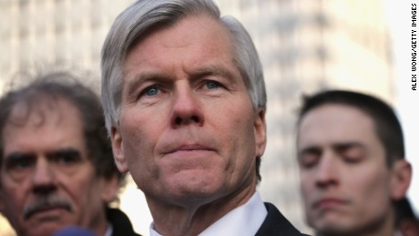 Former Virginia Governor Robert McDonnell (C) pauses as he speaks to members of the media outside U.S. District Court for the Eastern District of Virginia after his sentencing was announced by a federal judge January 6, 2015, in Richmond, Virginia.