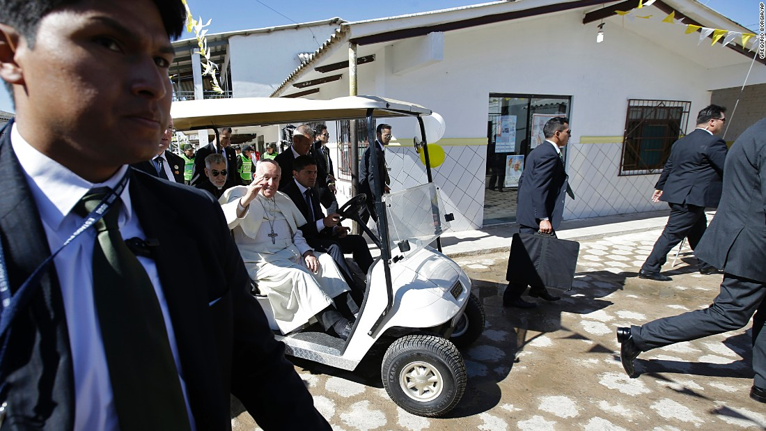 Pope Francis waves from a golf cart after visiting with prisoners in Santa Cruz, Bolivia, on Friday, July 10. The Pope wrapped up his trip to Bolivia with a visit to its notoriously violent and overcrowded Palmasola prison. Francis, born in Argentina, is emphasizing the plight of the poor during his eight-day tour of South America.