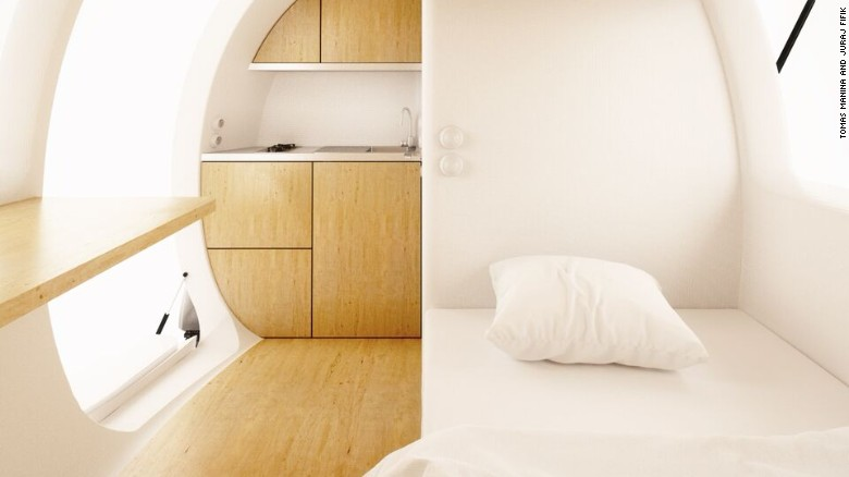 The capsule makes ingenious use of interior space, including a bedroom, kitchenette, workspace, dining room and en-suite bathroom.