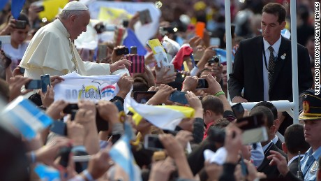 Pope Francis makes his way through the streets of Caacupe as he heads to the Marian Shrine of Caacupe, to deliver mass to hundreds of thousands of pilgrims on July 11.