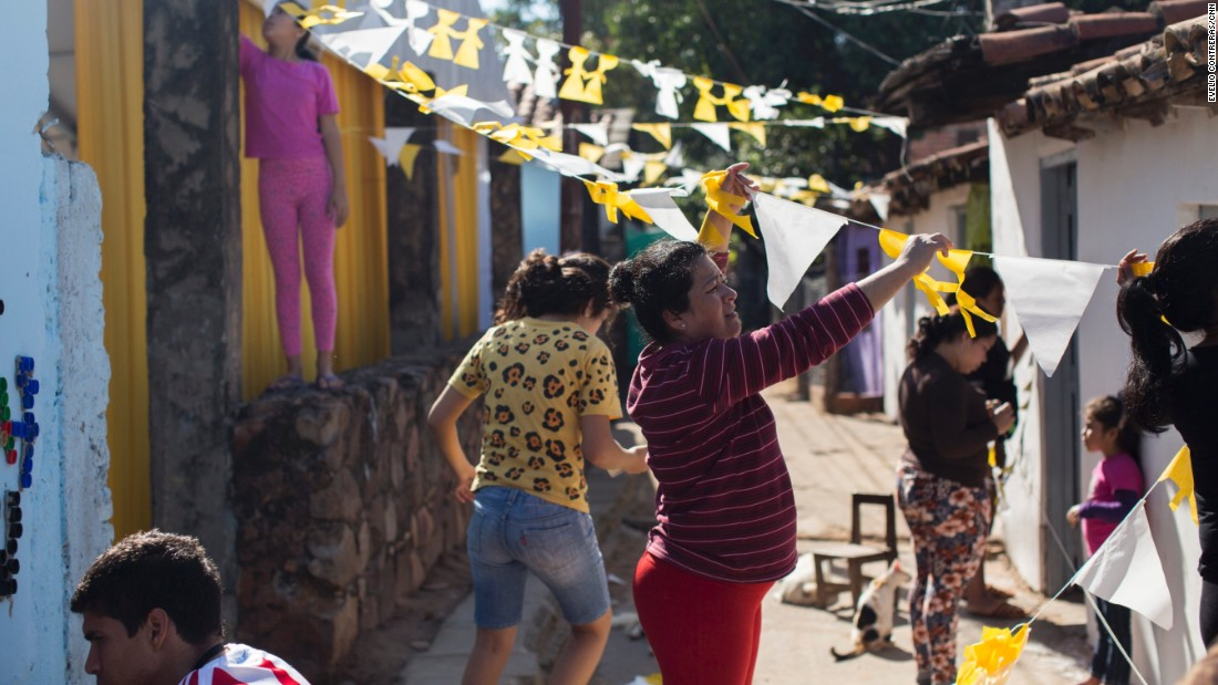 Mercedes Paredes decorates her neighborhood where Pope Francis will visit three families during his visit in Asuncion.