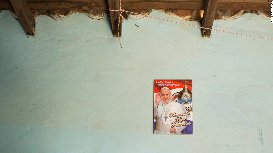 Asuncion Jimenez has a sole poster of Pope Francis hanging beneath a ceramic tile roof.
