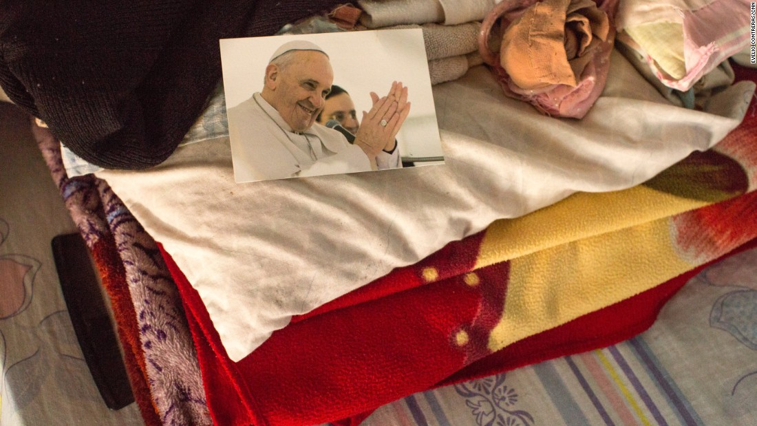 Asuncion Jimenez keeps a picture of Pope Francis by her bed. The mother of four and grandmother of 15 says she's full of emotion and anticipation.<br />