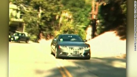 vehicle driving in reverse down busy road california dnt_00012903