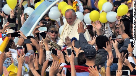 Pope Francis arrives for the mass on July 12.