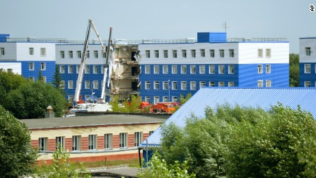 Monday's collapse left a gaping hole in the side of a training center barracks in the Omsk region of Russia.