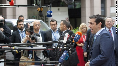 Greek Prime Minister Alexis Tsipras arrives for a meeting of eurozone heads of state at the EU Council building in Brussels on July 12, 2015.