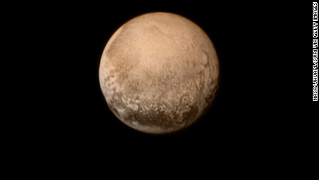In this handout provided by the National Aeronautics and Space Administration (NASA), the dwarf planet Pluto (R) and Charon are shown July 11, 2015.