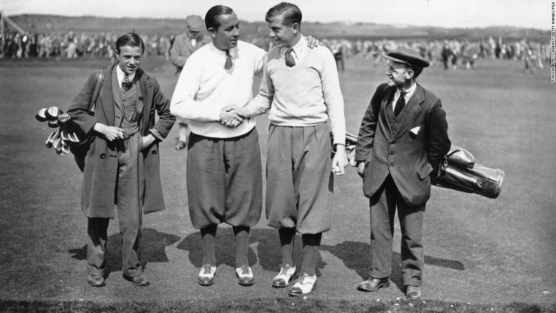 "U.S. golf star Walter Hagen (left) shakes hands with Britain's Henry Cotton after the American won his fourth and final Open Championship at Muirfield in 1929. Dressed in plus fours, shirts, ties and v-neck sweaters, the pair were a dapper sight on the course. <br /><br />""Walter Hagen loved wearing smart clothing and was known to talk about being a millionaire. He really liked bright colors,"" Fleming said."