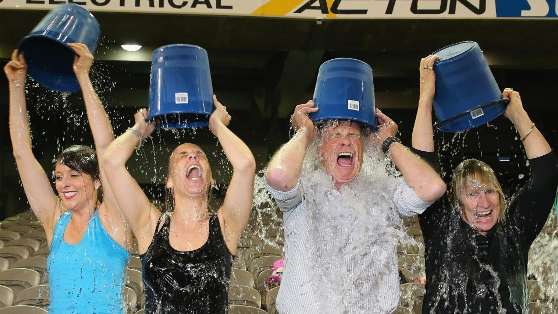 Participants tip buckets of ice water over their heads as they take part in the World Record Ice Bucket Challenge at Etihad Stadium on August 22, 2014 in Melbourne, Australia. Over 700 people took part in setting the new world record. The Ice Bucket Challenge is the social media phenomenon which is helping raise awareness and money for sufferers of Motor Neurone Disease.