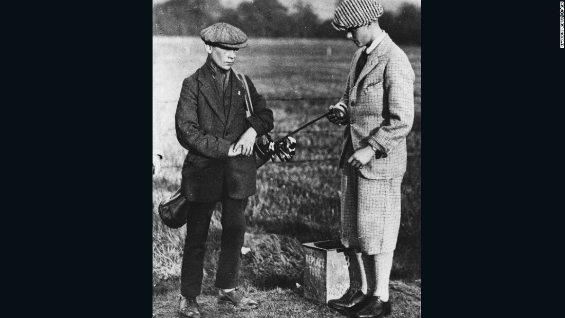 "A young King Edward VIII (right) seen here in 1916. Then the Prince of Wales, he was a golf lover and wore ""typical golfing dress rather than royal wear,"" Fleming says. His relaxed choice of clothing extended to wearing Fair Isle sweaters, which he helped popularize. The distinctive, multicolored weave is named after the small island in Shetland off Scotland's northeast coast.<br /><br />When Edward was appointed Captain of the Royal and Ancient Golf Club in 1922, a crowd of 6,000 onlookers watched him complete the ""Drive into Office"" (a ceremony on the first tee to mark the start of a new club captain's tenure) wearing a round-neck Fair Isle sweater.<br /> <br />""Knitwear became a look of its own and people would wear it outside the golf course -- thanks in part to Scottish knitwear companies like Pringle and Lyle and Scott,"" Fleming says."