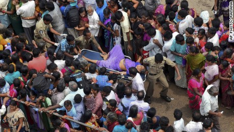 A woman is rushed to a hospital on a stretcher after a stampede during a Hindu religious bathing festival on the bank of the Godavari River in the Indian state of Andhra Pradesh on July 14, 2015. The stampede occurred as tens of thousands of people pushed forward to bathe in the river on the first day of the Pushkaralu festival, an official said.