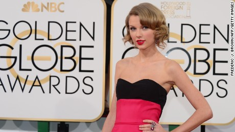 Singer Taylor Swift arrives on the red carpet for the Golden Globe awards on January 12, 2014 in Beverly Hills, California. AFP PHOTO / Frederic J. BROWN (Photo credit should read FREDERIC J. BROWN/AFP/Getty Images)