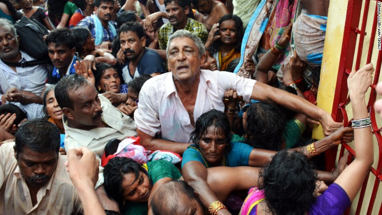 Indian devotees after a stampede at a religious festival in Godavari in the Rajahmundry district on July 14.