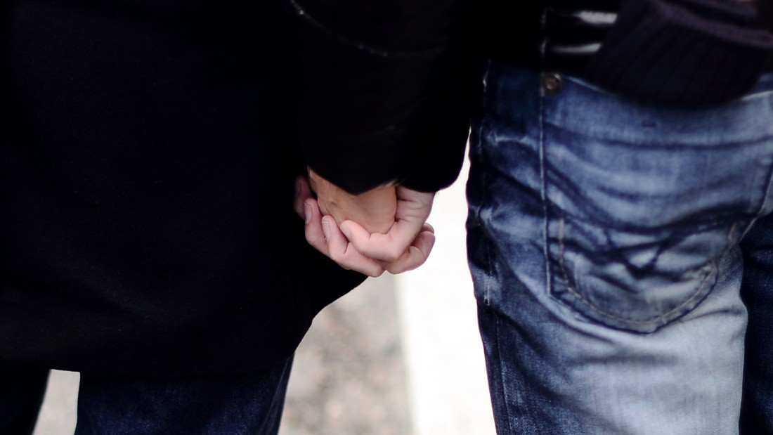 Two men hold hands during a demonstration for the legalisation of gay marriage and LGBT (lesbian, gay, bisexual, and transgender) parenting in Paris on December 16, 2012 . AFP PHOTO / LIONEL BONAVENTURE (Photo credit should read LIONEL BONAVENTURE/AFP/Getty Images)