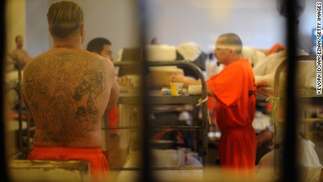 Caption:CHINO, CA - DECEMBER 10: Inmates at Chino State Prison walk in between their double bunks beds in the overcrowded dayroom of Sycamore Hall that was modified to house prisoners on December 10, 2010 in Chino, California. The U.S. Supreme Court is preparing to hear arguments to appeal a federal court's ruling last year that the California state prison system would have to release 40,000 prisoners to cope with overcrowding so severe that it violated their human rights. More than 144,000 inmates are currently incarcerated in prisons that were designed to hold about 80,000. (Photo by Kevork Djansezian/Getty Images)