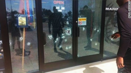http://i2.cdn.turner.com/cnnnext/dam/assets/150716130834-bullet-holes-photo-chattanooga-shooting-lv-00000000-large-169.jpg
