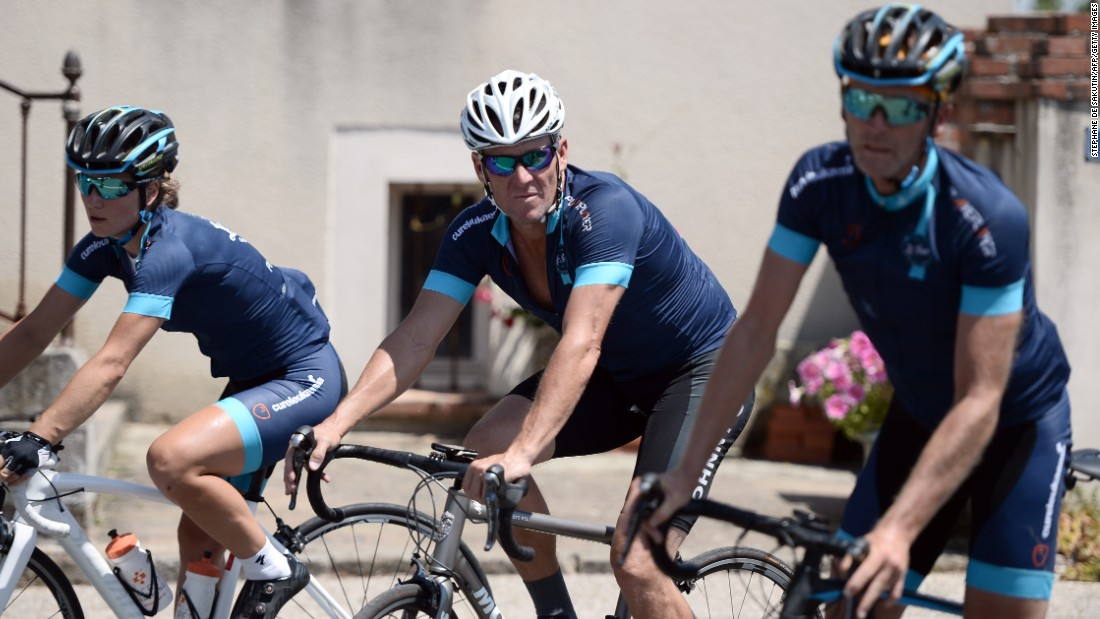 Disgraced cyclist Lance Armstrong (center) took part in a charity race over two stages of this year's Tour de France. The 43-year-old American was stripped of his seven Tour titles after admitting doping. He was raising money for a  leukaemia charity but cycling officials  branded the exercise 'disrespectful'.