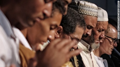 People pray during a celebration of Eid al-Fitr marking the end of the fasting month of Ramadan in Saluzzo, near Turin, on July 17, 2015. Muslims around the world are celebrating Eid al-Fitr this week, marking the end of the holy month of Ramadan during which followers are required to abstain from food, drink and sex from dawn to dusk. AFP PHOTO / MARCO BERTORELLO        (Photo credit should read MARCO BERTORELLO/AFP/Getty Images)