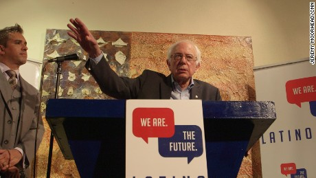 Democratic presidential candidates under pressure at liberal event