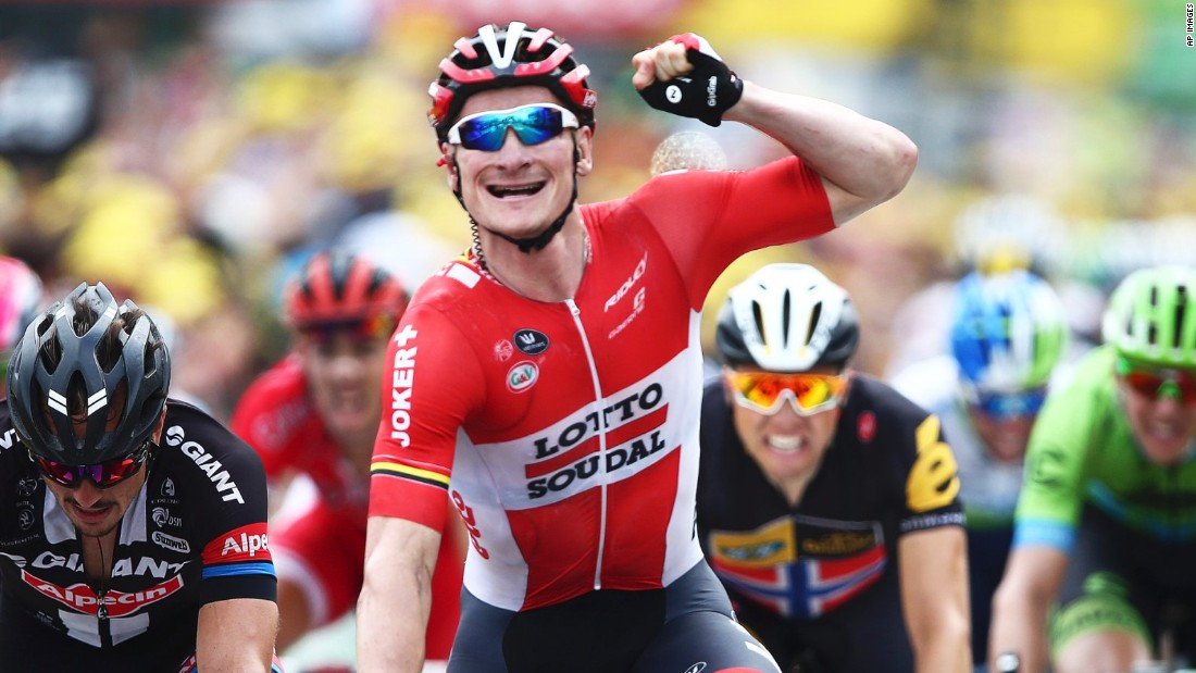 Greipel celebrates his hat-trick of stage wins on the 2015 Tour de France and rounded off the Tour with his fourth on the Champs Elysees.