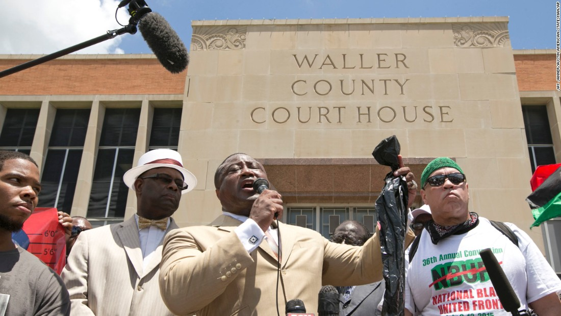 Quanell X, leader of the New Black Panther Party, holds a plastic bag while speaking at a rally at the Waller County Courthouse in Hempstead, Texas, on Friday, July 17. Authorities said there were no cameras in Bland's jail cell to show that she hanged herself, but cameras in the hallway show no one entering or leaving the cell before her body was discovered.