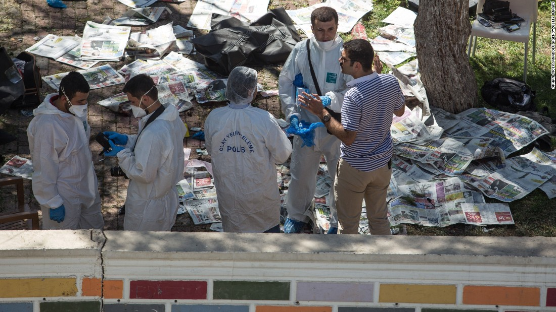 Police inspect the blast site on July 20.