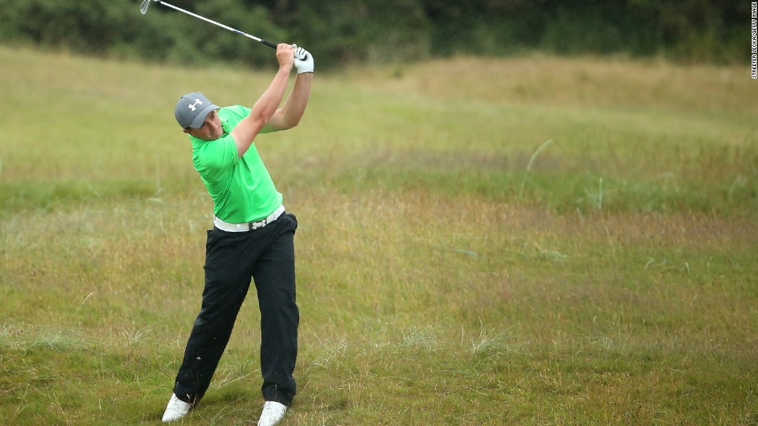 Irish amateur Paul Dunne -- top of the leaderboard entering the final day before finishing tied for 20th -- plays a shot on the fifth hole during the final round.