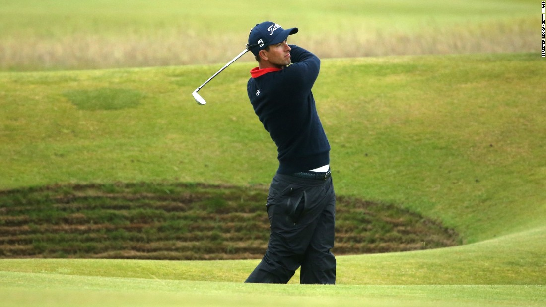 Adam Scott of Australia finished tied for 10th place. Here he plays an approach on the 14th hole.