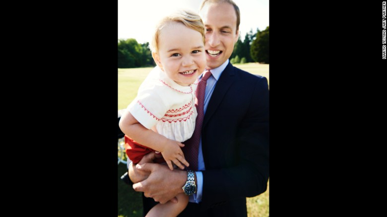 Prince George is held by his father, Prince William, in this photo released July 21 -- the day before his second birthday.