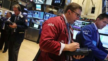 Traders work on the floor of the New York Stock Exchange on July 13, 2015 in New York City.