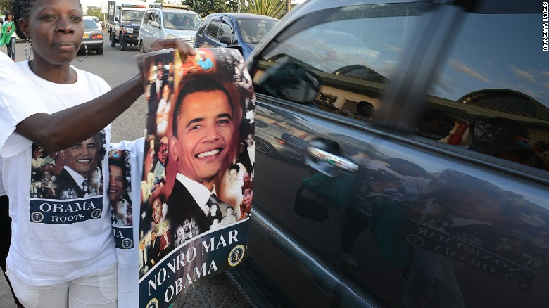 Posters with the image of Barack Obama are offered for sale to motorists in Nairobi, ahead of the U.S. president's visit to Kenya.