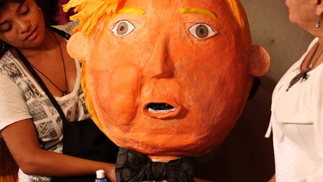 "A Trump piñata is set up inside Lorena Robletto's shop in downtown Los Angeles. Piñatas in Trump's image <a href=""http://www.cnn.com/2015/07/22/politics/maevewest-donald-trump-2016-silent-majority/"">became hot sellers</a> following outrage and anger over his rhetoric about Mexican immigrants."