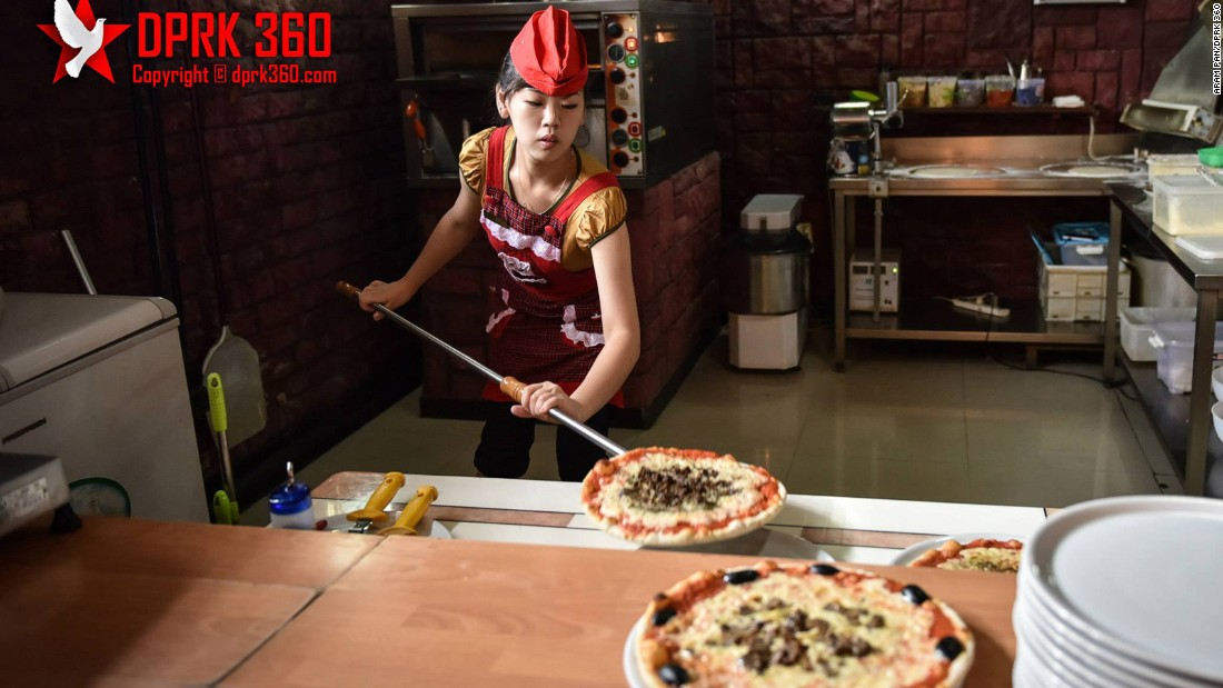 """Pyongyang's Italian pizzeria, opened in 2009, is another unexpected sight in the North Korean capital. <a href=""""http://www.dprk360.com/360/pyongyang_italian_restaurant/""""  it in 360 degrees here</a>."""