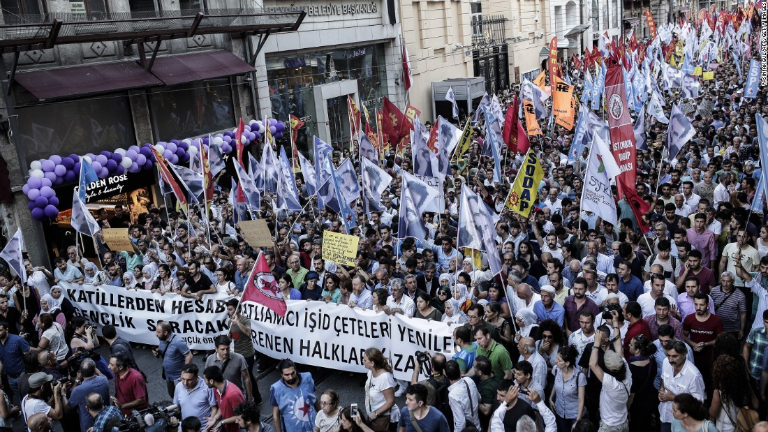 Protesters turn out with anti-ISIS banners and flags to show support for victims of the Suruc suicide blast during a demonstration July 20 in Istanbul.