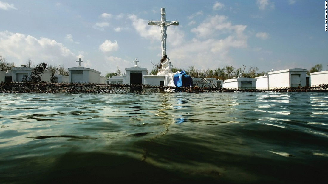 Water floods a cemetery outside St. Patrick's Church in Plaquemines Parish, Louisiana, on September 11, 2005.