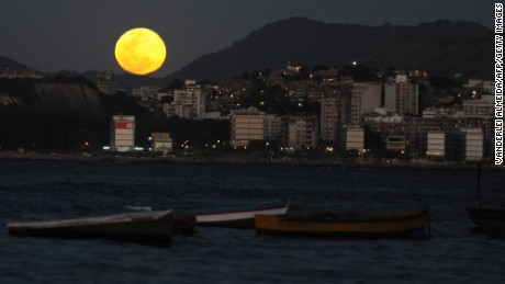The full moon rises over Rio de Janeiro on August 31, 2012. According to NASA, this is the second time in August that a full moon is seen - the first was on August 1 to 2. This phenomenon, which is referred to as the 'blue moon', happens every two and a half years on average. AFP PHOTO/VANDERLEI ALMEIDA (Photo credit should read VANDERLEI ALMEIDA/AFP/Getty Images)