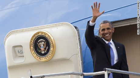 U.S. President Barack Obama waves as he boards Air Force One prior to his departure from Kenyatta International Airport in Nairobi on Sunday, July 26.