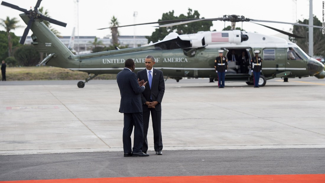 Obama talks with Kenyan President Uhuru Kenyatta in front of Marine One in Nairobi on July 26. The U.S. President called on Kenya's leaders to reject ethnic divisions and government corruption.