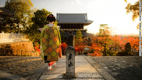 <Image 1: A geisha might cross your path at any time in this city of living traditions. -- Image courtesy of Jeffrey Friedl http://regex.info/blog/>