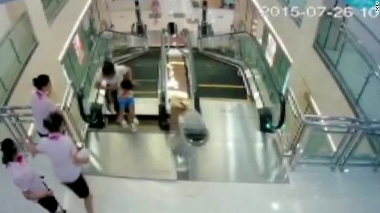 Man watches wife die in China escalator accident