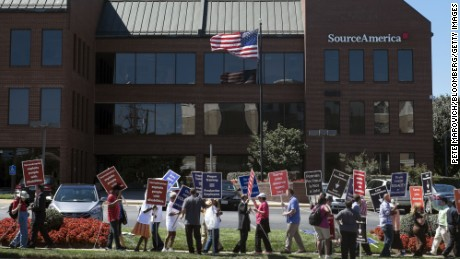 Members of the National Federation of the Blind and other advocacy groups for the disabled demonstrate outside SourceAmerica headquarters in Vienna, Virginia, U.S., on Thursday, Aug. 28, 2014. The protesting groups claim SourceAmerica discriminates against workers with disabilities by permitting its qualified nonprofits to pay them less than the federal minimum wage. Photographer: Pete Marovich/Bloomberg via Getty Images