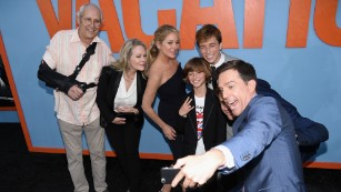 "(L-R) Actors Chevy Chase, Beverly D'Angelo, Christina Applegate, Steele Stebbins, Skyler Gisondo take a selfie with Ed Helms during the premiere of Warner Bros. Pictures ""Vacation"" at Regency Village Theatre on July 27, 2015 in Westwood, California."